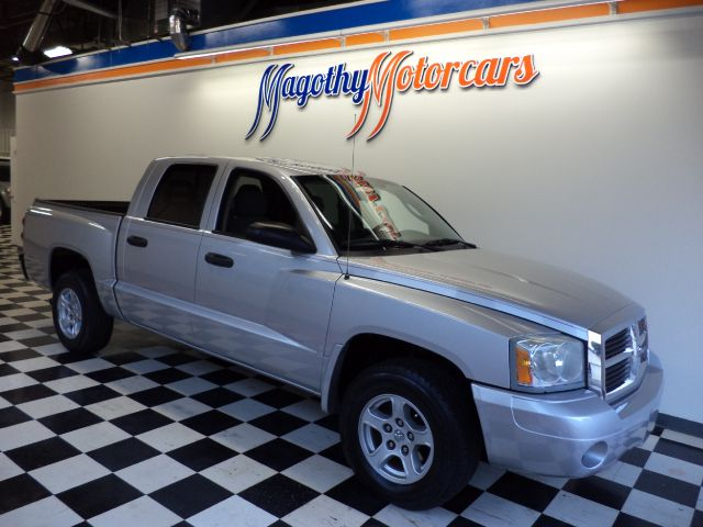 2007 DODGE DAKOTA SLT QUAD CAB 2WD 102k miles Here is a great running new car trade in that has ar